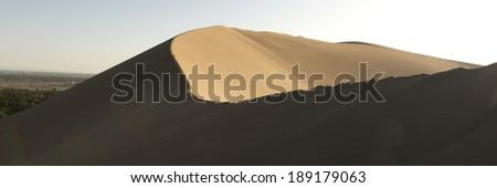 Singing sand dunes at Mingsha Shan, Gobi Desert, Dunhuang, Jiuquan, Gansu Province, China - stock photo