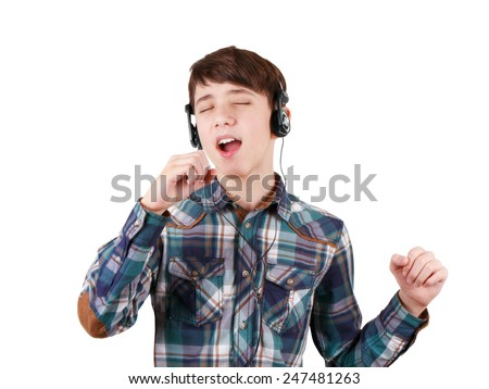 Singing teen boy in headphones listening to music and showing hand sign isolated on white background - stock photo