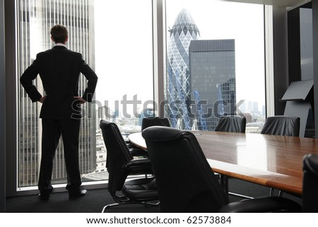 Single adult business man waiting for meeting to begin in Board room - stock photo