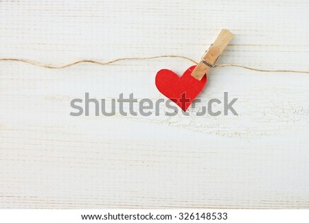 single bright red heart pinned twine wooden empty background - wall hanging home decor for valentines day and lovely special occasions to beloved - stock photo