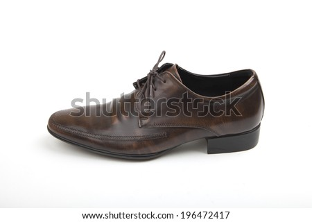 Single brown leather Polished mans classic lace-up shoe fashion accessory sideways on a white background - stock photo