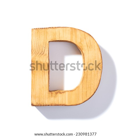 Single brown wooden D letter with 45 degree long shadow as a real life flat design font, isolated over the white background - stock photo