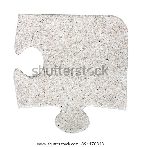 Single cardboard jigsaw puzzle piece isolated on white - stock photo