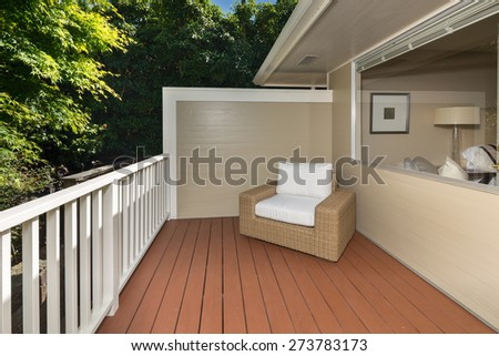 Single chair on wooden deck. Modern outdoor furniture on wooden deck. - stock photo
