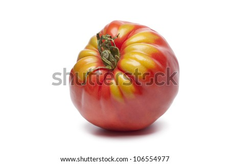 Single Coeur de Boeuf tomato on white background - stock photo