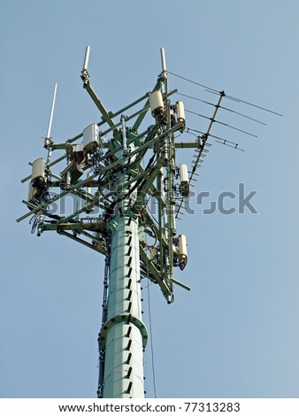 Single Communication Tower Over a Blue Sky - stock photo