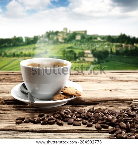 single cup of coffee and croissants  - stock photo