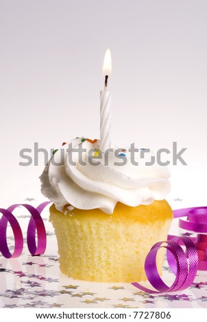 Single cupcake with White Candle - stock photo