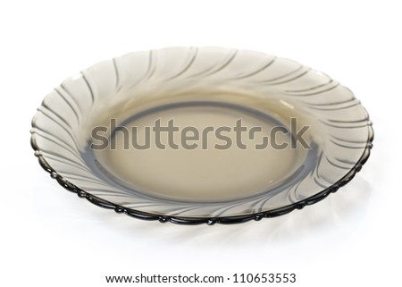 Single dark transparent plate isolated on white background - stock photo