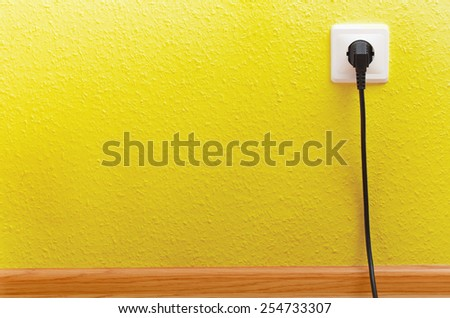 Single electric socket with plug on wall - stock photo