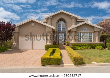 Single family house with two levels and a short driveway. - stock photo