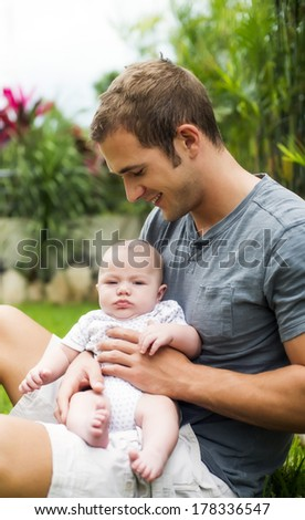 Single father with his newborn baby - stock photo