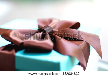 Single gift green box with brown ribbon - stock photo
