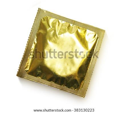 Single gold condom on white background.  - stock photo