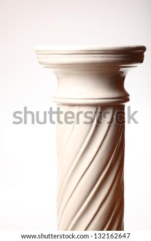 Single greek column on white background - stock photo