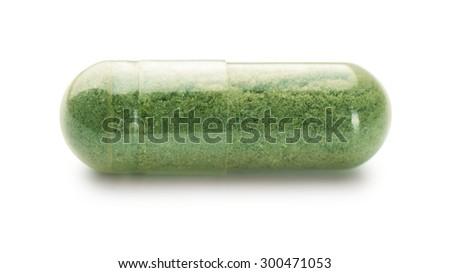 Single herbal capsule isolated on white - stock photo