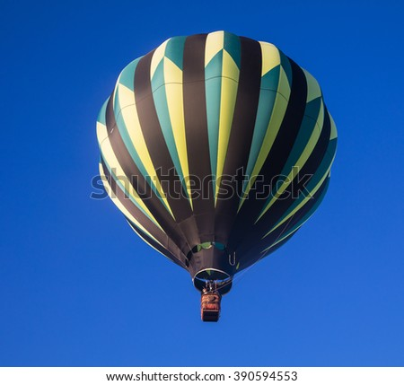 Single hot air balloon just after launch - stock photo