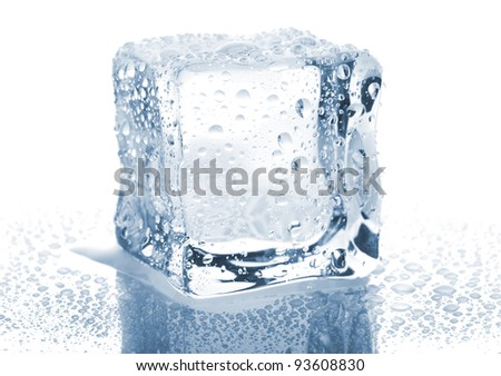 Single ice cube with water drops isolated on white background - stock photo