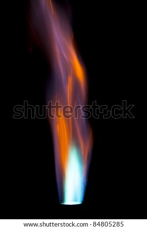 Single intense gas jet flame against a black background - stock photo