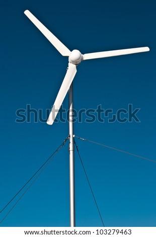 Single isolated and rotating wind turbine. Eolian power - stock photo