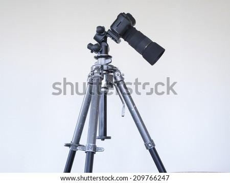 Single-lens Reflex Camera attached to the Tri-pod - stock photo
