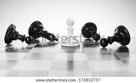 Single little pawn defeating enemies. - stock photo
