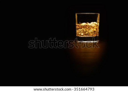 Single Malt Whiskey in a glass on a wooden table top with space for text, landscape. - stock photo