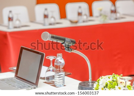 single microphone with business laptop in conference - stock photo