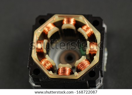 single phase induction motor open showing windings and coils - stock photo
