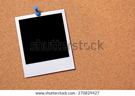 Single polaroid frame, pushpin, cork board background.  Copy space - stock photo