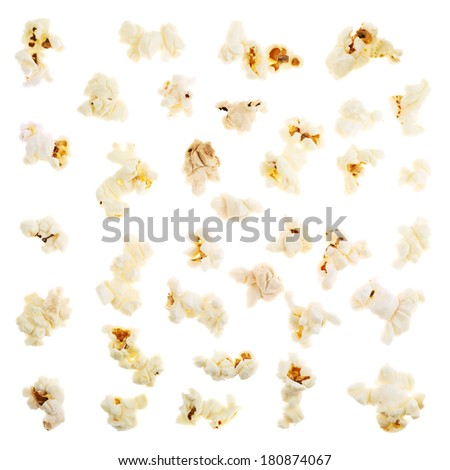 Single popcorn pieces isolated over the white background - stock photo