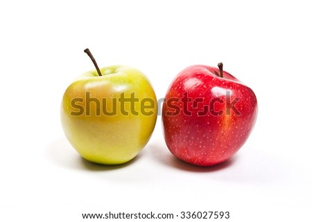 Single red apple and one green apple. Juicy ripe fruits.  Isolated on white background. - stock photo