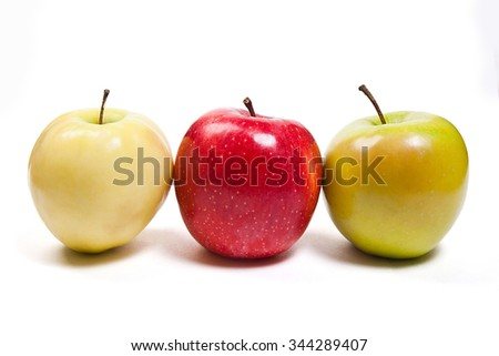 Single red apple, one green apple and one yellow apple. Group of juicy ripe fruits.  Isolated on white background. - stock photo