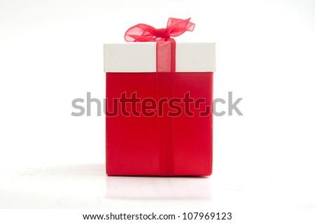 Single red gift box on white - stock photo