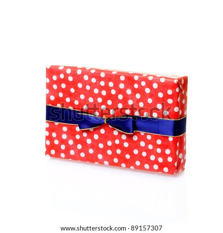 Single red gift box with blue ribbon on white background. - stock photo