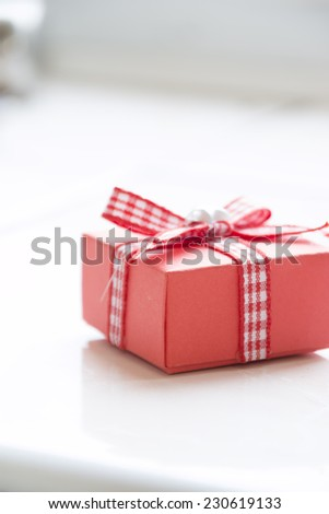 Single red gift box with  ribbon  - stock photo