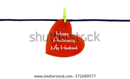 Single red love shape with text HAPPY ANNIVERSARY MY HUSBAND clipped on blue rope isolated on white background - stock photo