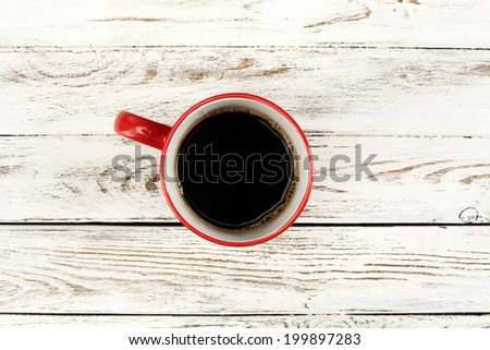 single red mug and white wooden top  - stock photo