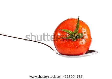 Single redtasty tomato on a silver spoon - stock photo