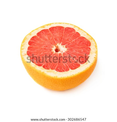 Single ripe fresh grapefruit cut in half isolated over the white background - stock photo