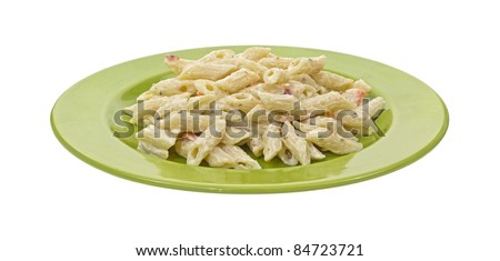 Single serving of pasta with Italian seasoning on a green dish. - stock photo