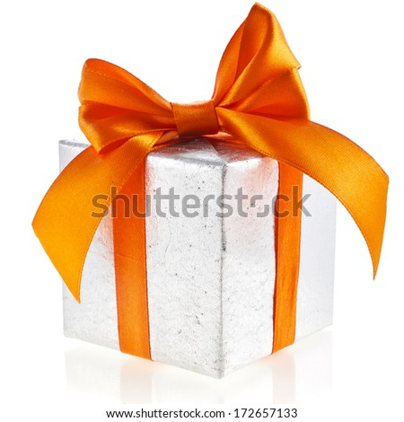 Single silver present box with orange  ribbon bow isolated on white background - stock photo