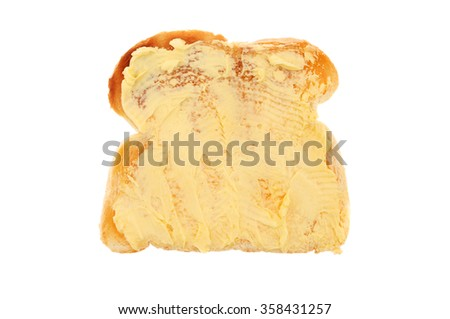 Single slice of buttered toast isolated against white - stock photo