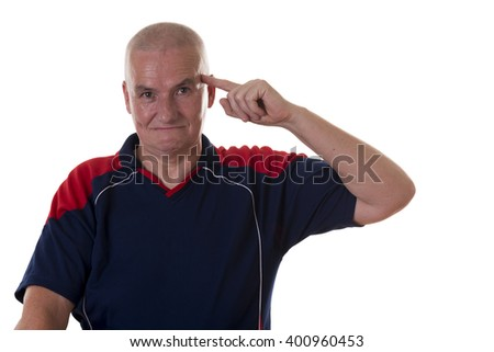 Single smart bald man in blue and red shirt with restrained grin pointing to his head with index finger over white background - stock photo