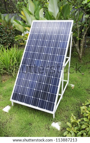 Single solar panel stand alone on the field. - stock photo