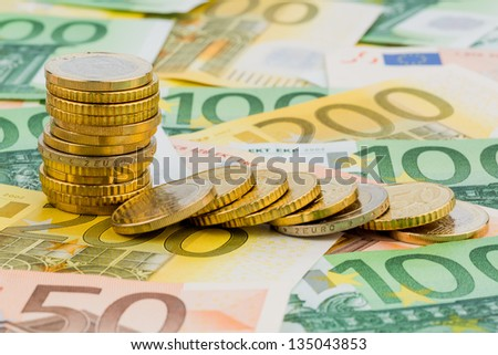 single stack coins, coins lying, symbolic photo for investment, risk and profit slump - stock photo
