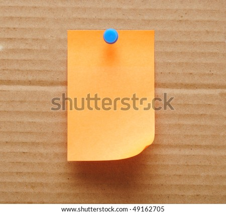 single sticky note over brown cardboard background - stock photo