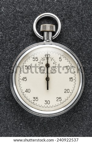 Single stopwatch in closeup on gray background - stock photo