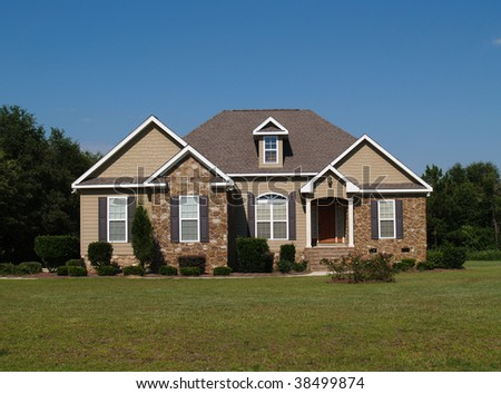 Single story stone and vinyl residential home. - stock photo