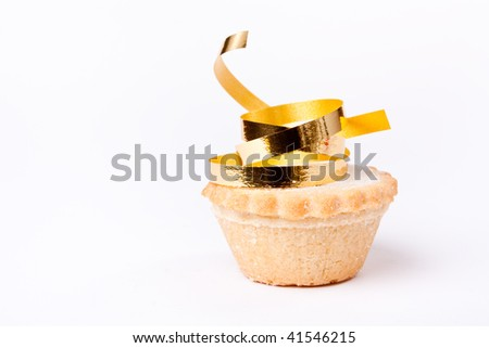 Single Sweet Mince Pie isolated against white background with gold ribbon. - stock photo
